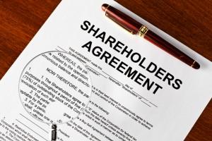 Magnifying glass on shareholders agreement